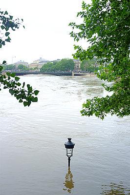 Street lamp submerged in the river Seine - p1096m1165425 by Rajkumar Singh