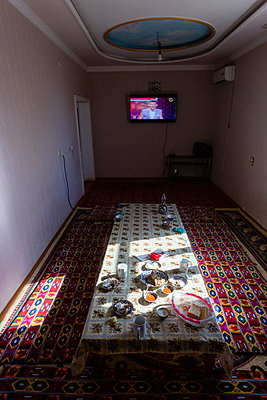 Table dressed in a traditional fish restaurant in Uzbekistan - p590m2057422 by Philippe Dureuil