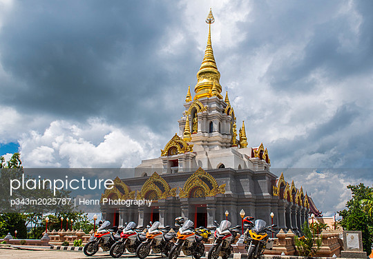 Motorcycles parked near stupa, Nan, Mueang Chiang Rai District, Thailand