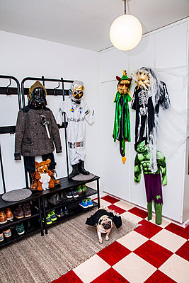Fancy dress costumes hanging in hall - p312m2217201 by Sara Winsnes