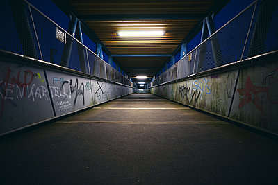 Dark and empty footbridge - p1696m2293003 by Alexander Schönberg