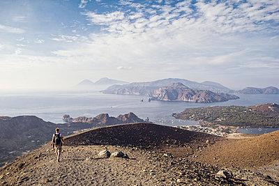 Aeolian Islands, Vulcano, Hiker at the volcano - p300m2104315 by Maria Maar