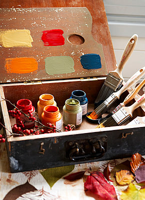 Paint brushes and paint pots with sample colours in vintage suitcase;  Isle of Wight;  UK - p349m920050 by Rachel Whiting
