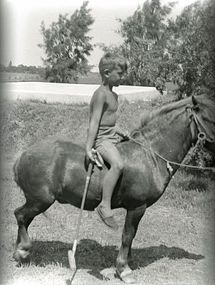 Boy on a horse - p0740047 by Maria Luisa Witte