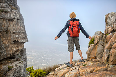 Young man on a hiking trip high in the mountains - p1355m1574142 by Tomasrodriguez