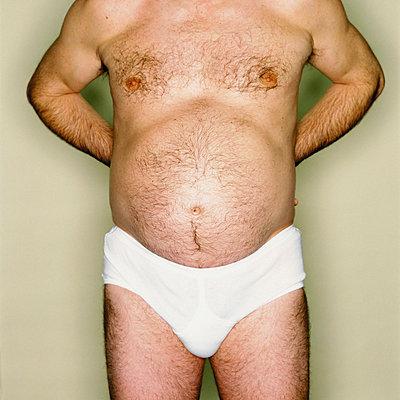 Male abdomen - p92410459f by Image Source