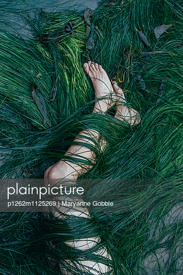 Legs Wrapped in Green Seaweed - p1262m1125269 by Maryanne Gobble