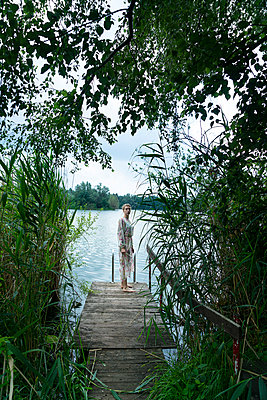 Woman by the lake - p427m2109554 by Ralf Mohr