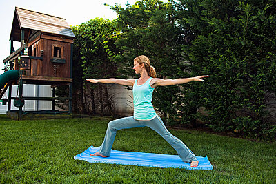Woman doing yoga in garden - p9243336f by Image Source