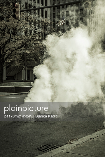 Steam surging from the road, Detroit - p1170m2145245 by Bjanka Kadic