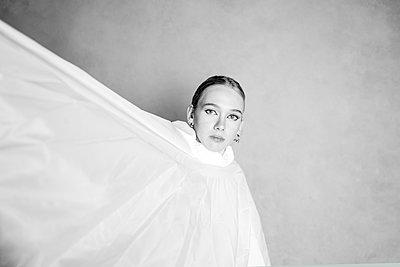 Woman with white cape - p1508m2220138 by Mona Alikhah