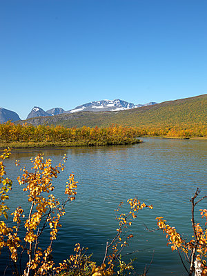 Mountain lake and peaks in Lapland - p1216m2184520 by Céleste Manet