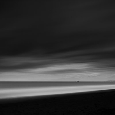 Long exposure shot of the sea and moody clouds in Kugenuma, Kanagawa Prefecture, Japan - p1166m2201380 by Cavan Images