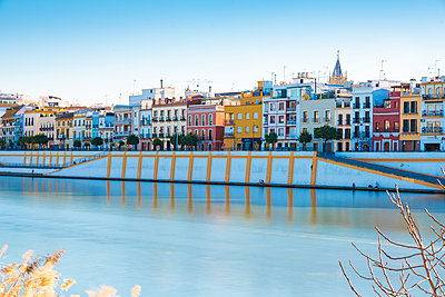 View over Canal de Alfonso XIII onto Betis Street, Sevilla, Spain - p1332m2203260 by Tamboly