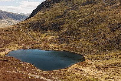 Mountain lake at Red Pike - p1477m2038952 by rainandsalt