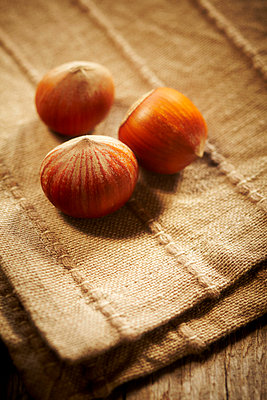 Hazelnuts on a napkin - p968m658846 by Roberto Pastrovicchio