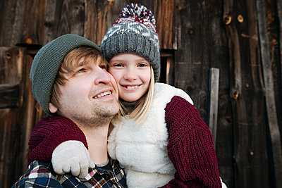 Happy daughter hugging father outdoors in winter - p300m2160068 by Ekaterina Yakunina