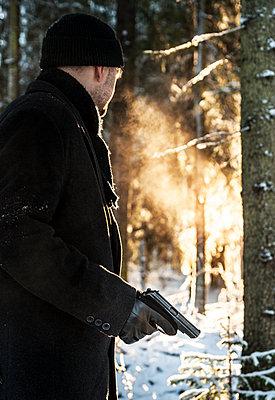Man with a gun  - p971m1094167 by Reilika Landen