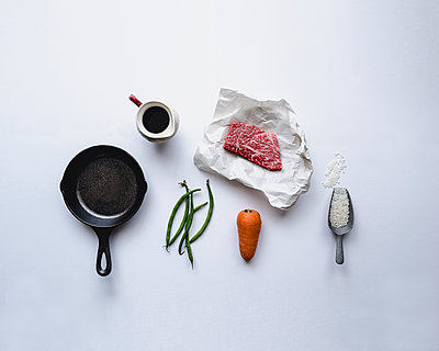 Directly above shot of ingredients on white background - p1166m1142996 by Cavan Images