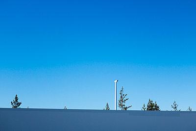 Wind turbine against blue sky - p1079m1042413 by Ulrich Mertens