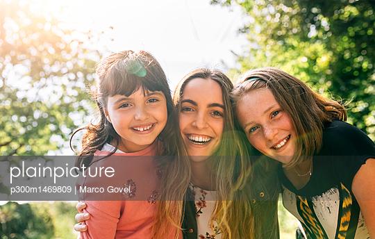 Portrait of three happy girls outdoors