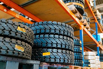 Tires on rack in auto repair shop - p300m2220691 by Ezequiel Giménez
