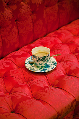Coffee and red couch - p4320582 by mia takahara