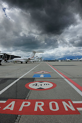 Dark cloud over airport - p1048m1058554 by Mark Wagner