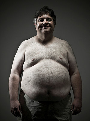 Overweight man - p9249447f by Image Source