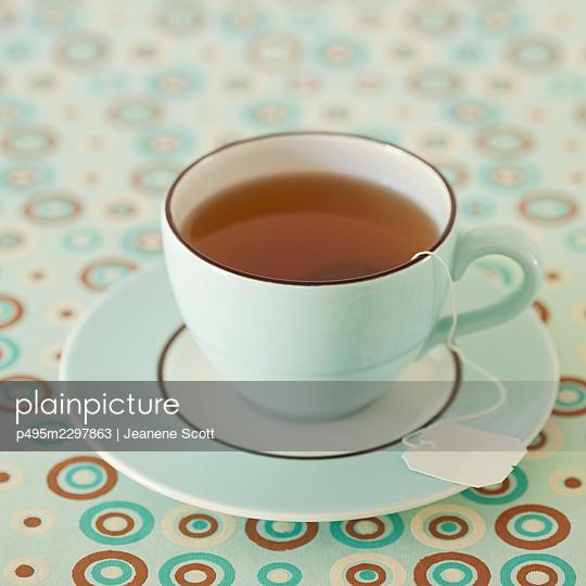 Organic green tea in a blue cup - p495m2297863 by Jeanene Scott