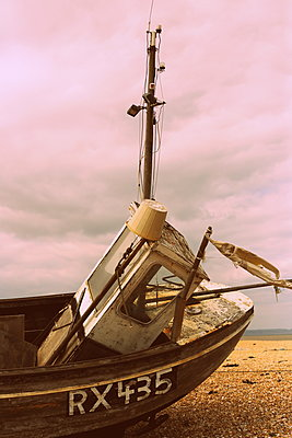 Old fishing boat on beach - p1063m1134986 by Ekaterina Vasilyeva