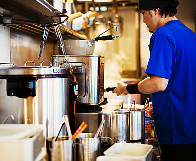 The ramen noodle shop. A chef working in a kitchen. - p1100m1185678 by Mint Images