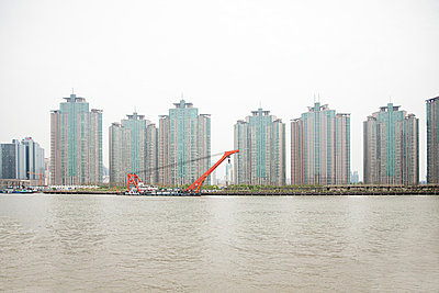 China, shanghai, apartment blocks and river - p9244868f by Image Source