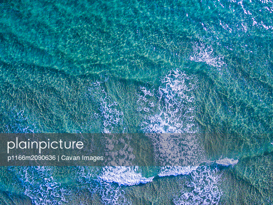 Aerial view of big waves in sea - p1166m2090636 by Cavan Images