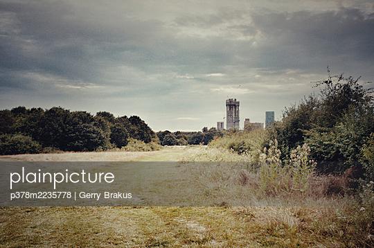 Skyline viewed from field - p378m2235778 by Gerry Brakus
