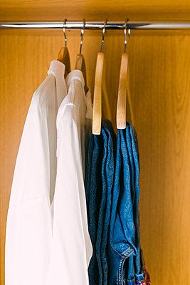 Clothes hanging in wardrobe - p1427m2109926 by Alexandra C. Ribeiro
