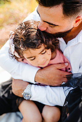 Father hugging daughter - p312m2249752 by Anna Johnsson