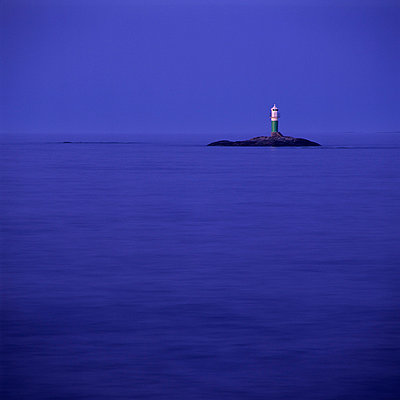 View of lighthouse on small island in middle of sea - p5756698 by Halling, Sven