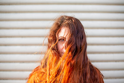 Young woman with long red hair - p975m2223803 by Hayden Verry
