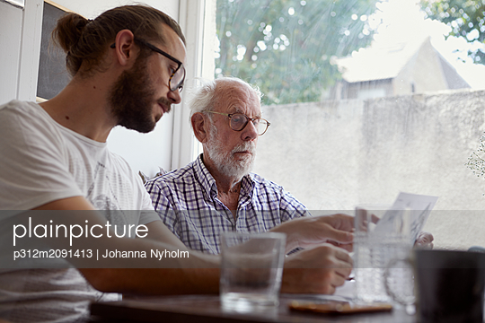 Man with adult son - p312m2091413 by Johanna Nyholm
