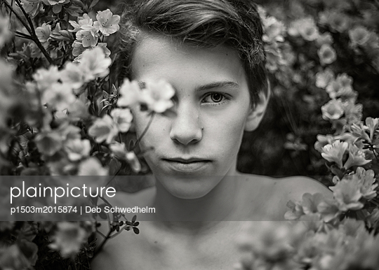 Boy in Flowers - p1503m2015874 by Deb Schwedhelm