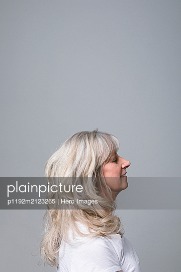 Profile portrait serene senior woman with eyes closed - p1192m2123265 by Hero Images