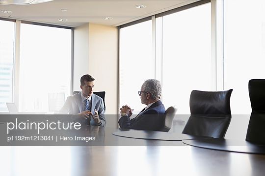 Male lawyers talking in conference room meeting