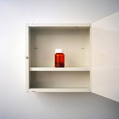 Medicine bottle in medicine chest - p3720363 by James Godman