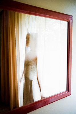 Woman behind curtain - p4130518 by Tuomas Marttila