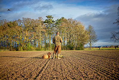Man and dog  - p1612m2223648 by Heidi Coppock-Beard