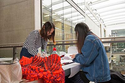 Seamstresses creating garment - p429m1513853 by G. Mazzarini