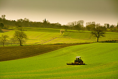 Farmer at work in his tractor. Auvergne. France. - p813m1223516 by B.Jaubert