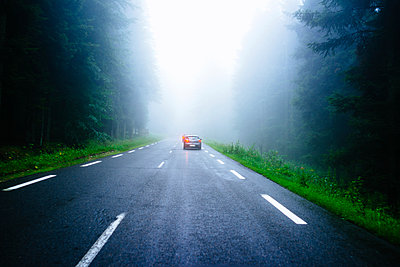 Road in the foggy morning - p1053m931727 by Joern Rynio