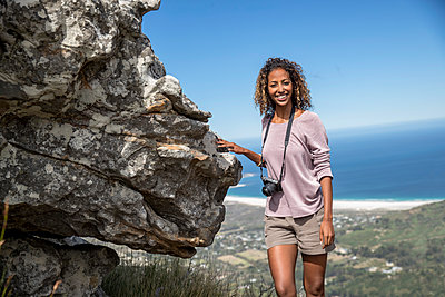 Young woman on hiking tour - p1355m1574189 by Tomasrodriguez